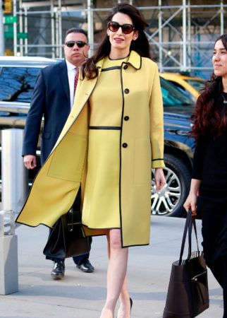 Amal Clooney is spotted arriving to the United Nations for a speech on human rights. The 39 year old who is expecting twins with actor husband George Clooney, looked stunning in sunglasses, a mustard dress with matching over coat and black heels. Please byline:TheImageDirect.com