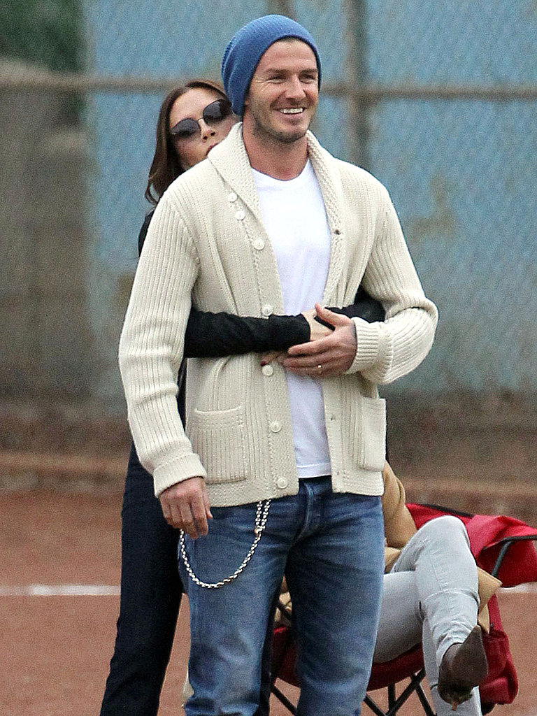 David and Victoria Beckham Moments - Cozying up at Football match