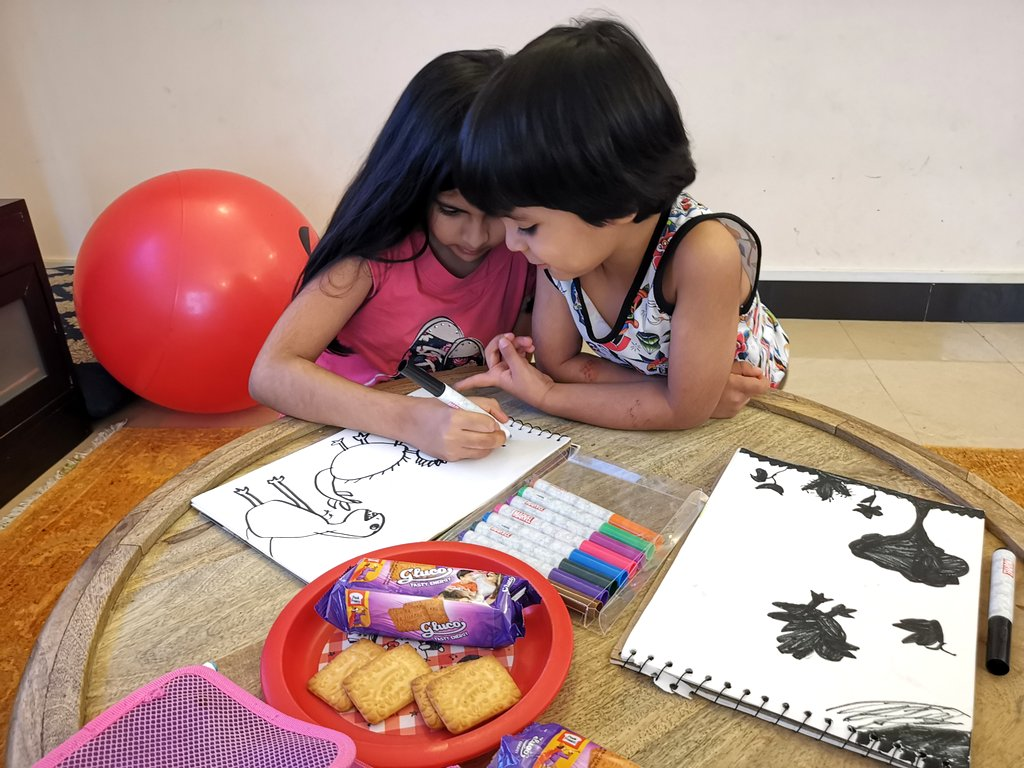Raniya and Zakriya working on an art activity in quarantine life